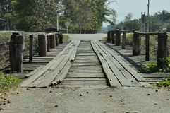 Bridge make from wood cross the river. Royalty Free Stock Photos
