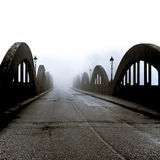 Bridge In Mist - Scotland. A river bridge in a small Scottish coastal town, shrouded in early morning mist Stock Images