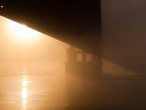 Bridge in the misty morning Stock Image