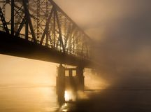 Bridge in the misty morning Royalty Free Stock Photography