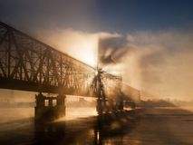 Bridge in the misty morning Stock Photography