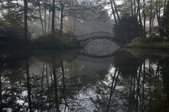Bridge in misty morning Stock Photo