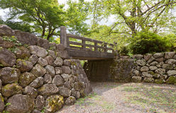 Bridge, moat and stone walls of Echizen Ohno castle in Ohno, Jap. Bridge over the moat and stone walls of Echizen Ohno castle. Castle was founded in 1576 by Royalty Free Stock Photo