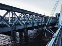 Bridge modern metal steels symbol blue sky water. London construction water modern Royalty Free Stock Image