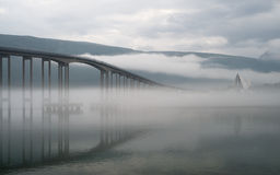 The bridge in a morning fog. Royalty Free Stock Photography