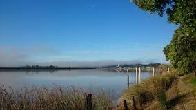 Bridge. Morning fog bridge Dargavile harbour river royalty free stock photography