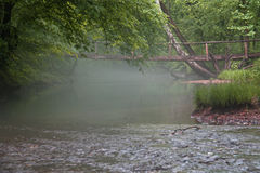 Bridge in morning mist Royalty Free Stock Photos
