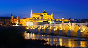 Bridge and  Mosque-cathedral of Cordoba in evening. Old roman bridge and  Mosque-cathedral of Cordoba in evening Stock Photo