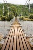 Bridge on Mount. Suspension bridge in the mountains Royalty Free Stock Image