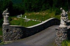 Bridge in mountains stock photography