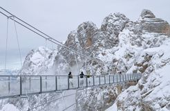 A bridge between mountains Stock Images