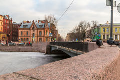 Bridge on the Moyka River, St. Petersburg, Russia. St. Petersburg, Russia - March 10, 2016: View of the Moyka River and bridge from the embankment Stock Photos