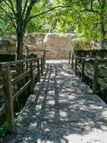Bridge in natural landscape with wooden railings stock photos