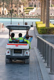 Bridge near down town in Dubai, UAE. DUBAI, UAE-NOVEMBER 14: Cleaners working in Bur Dubai Royalty Free Stock Photos