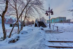 Bridge Near Light Post With Snow and Building at Distance Stock Image