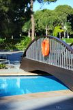 Bridge near the pool and lifeline. Royalty Free Stock Photography