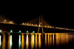 Bridge at night. Vasco da Gama Bridge and water reflection at night. Lisbon, Portugal stock image
