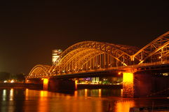 Bridge at Night. Hohenzollen bridge spanning the river rhine in cologne germany Stock Photos