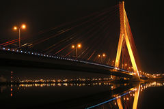 Bridge at night. Bridge and reflection in the Vistula river, Poland Royalty Free Stock Photography