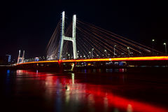 Bridge in night. ,The reflection of neon color Stock Image