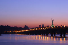 Bridge at night. One of the Kyiv's central bridges (Paton bridge) at night and a famous Motherland statue Stock Photos
