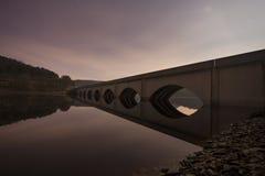 Bridge at night. Across a lake Stock Images