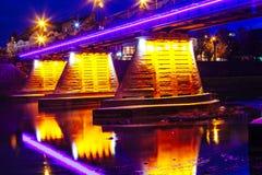Bridge night city reflected in water Uzhorod. Bridge night city reflected in water with lights and reflections. Uzghorod Uzhhorod Royalty Free Stock Image