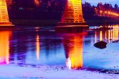 Bridge night city reflected in water Uzhorod. Bridge night city reflected in water with lights and reflections. Uzghorod Uzhhorod Stock Photo