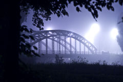 Bridge at night in the fog Royalty Free Stock Image