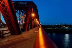 Bridge at night, with skyline in foreground royalty free stock photo