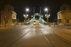 Bridge by night with tram in the distance Stock Photography