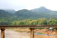Bridge over river in rainforest,Nong Khiaw,Laos Stock Images
