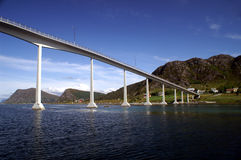 Bridge in Norway. Bridge in Noway with village and mountains in the background Royalty Free Stock Photos