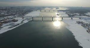 Bridge through Ob river in Novosibirsk. Communal bridge through Ob river in Novosibirsk at winter stock video footage