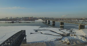 Bridge through Ob river in Novosibirsk. Railway bridge through Ob river in Novosibirsk at winter stock video footage