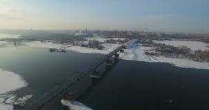 Bridge through Ob river in Novosibirsk. Railway bridge through Ob river in Novosibirsk at winter stock video