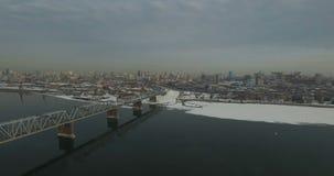 Bridge through Ob river in Novosibirsk. Railway bridge through Ob river in Novosibirsk at winter stock footage