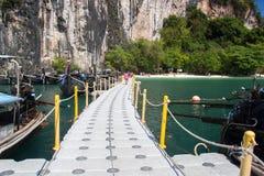 Bridge on ocean beach for passenger Royalty Free Stock Images