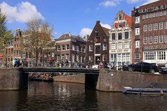 Bridge and old houses of traditional architecture along a canal stock photo