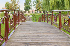 Bridge with an old padlocks in park. Stock Photography
