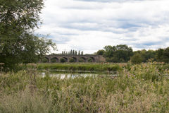 Bridge. Old railway bridge over a river and field Stock Image