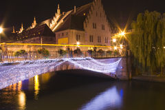 Bridge in old town strassbourg by night. Bridge in old town strassbourg in france by night historical buildings light decoration Royalty Free Stock Image