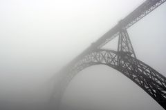Bridge of Oporto. An old bridge of Oporto (historical property of the humanity) in the mist Royalty Free Stock Photos