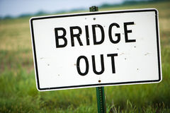 Bridge Out Sign With Bullet Holes and Green Pasture Stock Photography