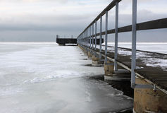Bridge ove icy water Royalty Free Stock Images