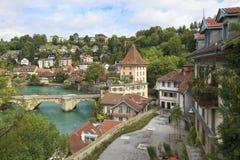 Bridge over Aare river in Bern, Switzerland. Bridge over Aare river and colorful town houses in Bern's Old Town district, Switzerland stock photo