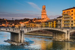 Bridge over Adige river in Verona, Duomo tower stock photo