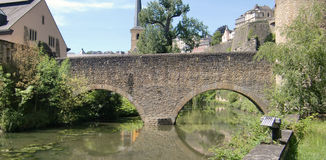 Bridge over Alzette river. Scenic view of arched bridge over Alzette river, Grund valley quarter, Luxembourg city Royalty Free Stock Photo