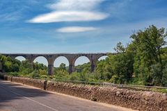 The bridge over the Ardeche river near the village of Vogue in t. He Ardeche region in France Royalty Free Stock Photo