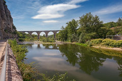 The bridge over the Ardeche river near the village of Vogue in t. He Ardeche region in France Stock Photography